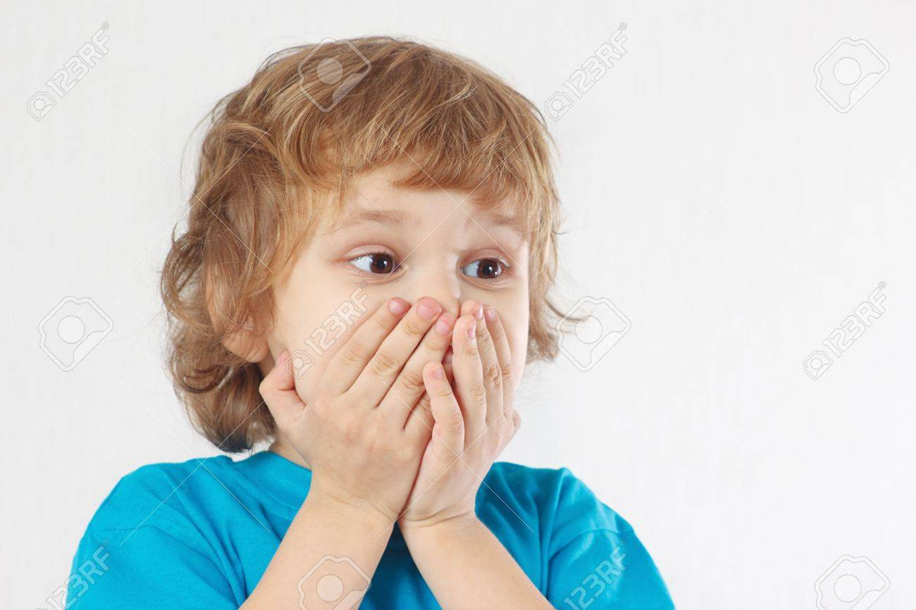 Little boy with the emotion of wonder on a white background Stock Photo - 17539520