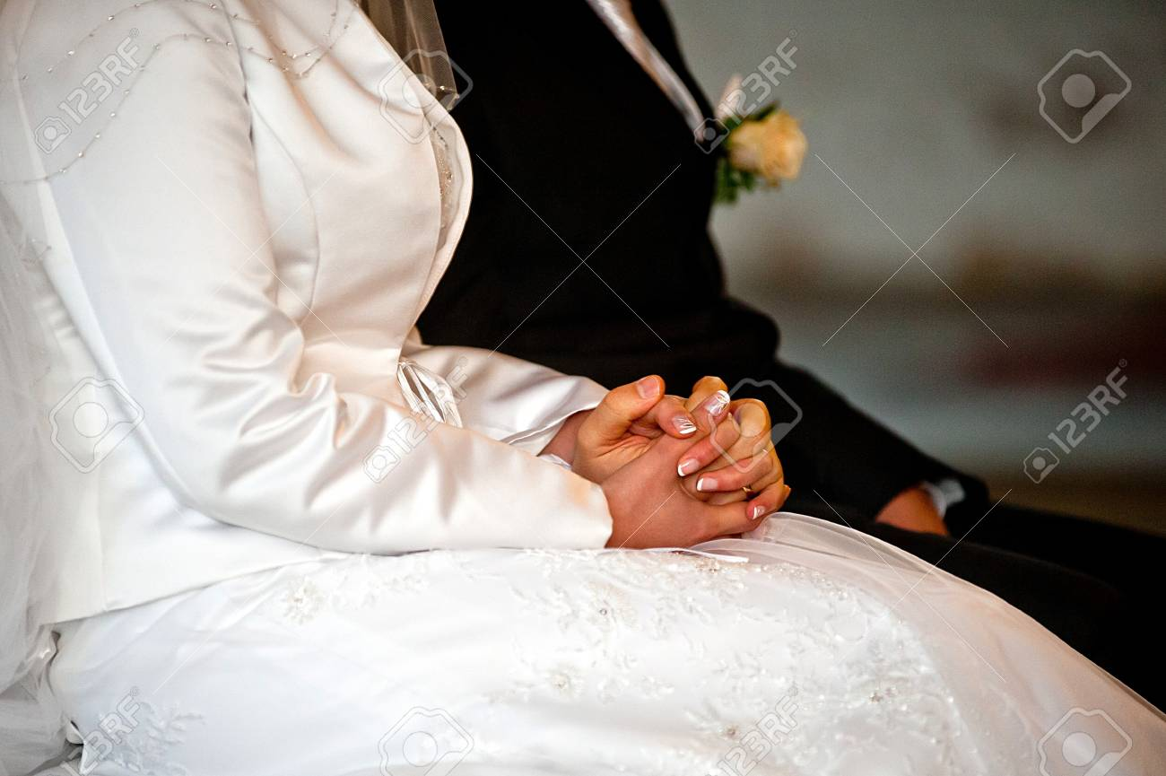 Wife and housband are holding hands  Bride has a manicure  Ring on finger Stock Photo - 16364200