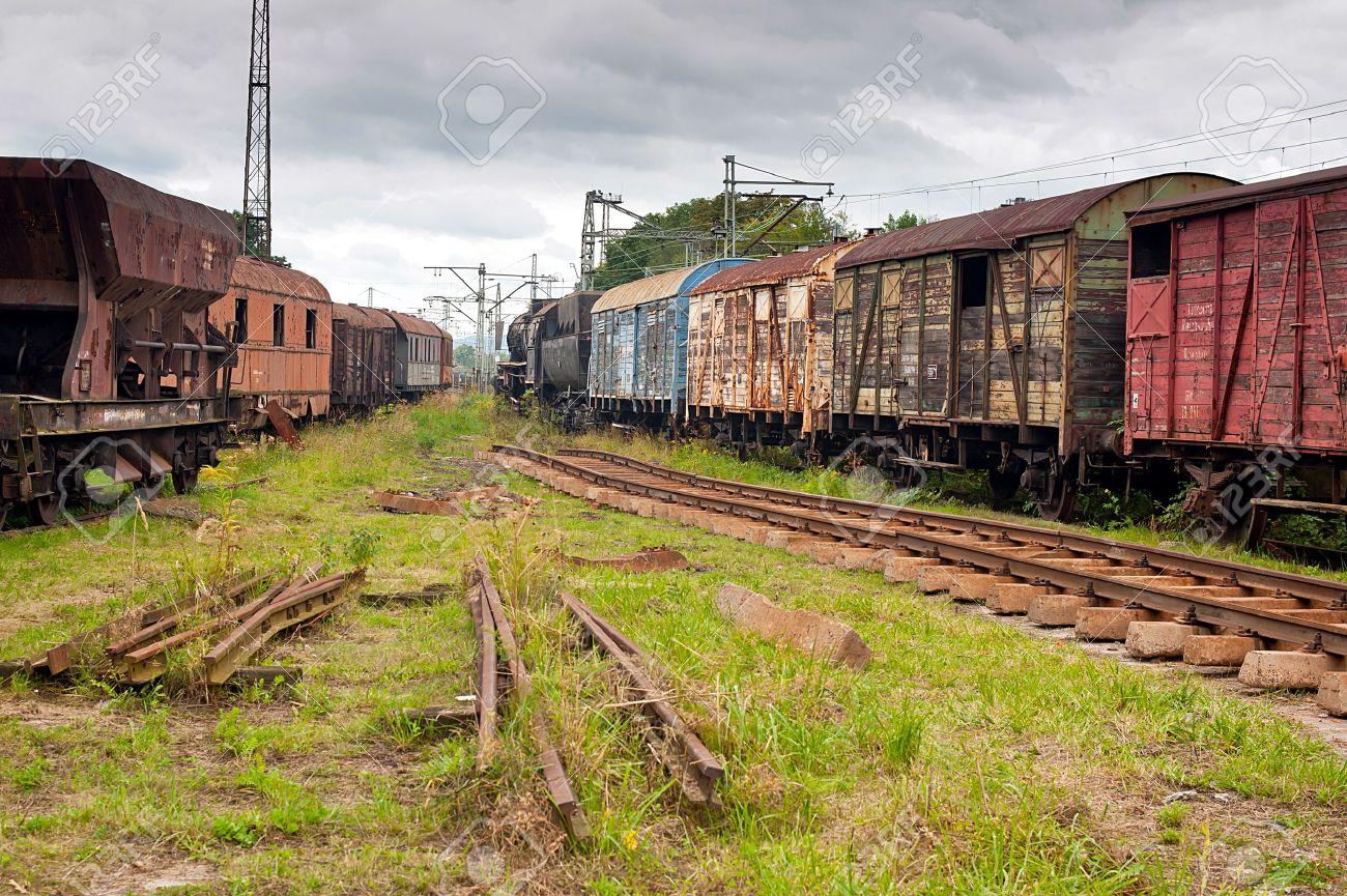 Abandoned old railway wagons at station - 19158520