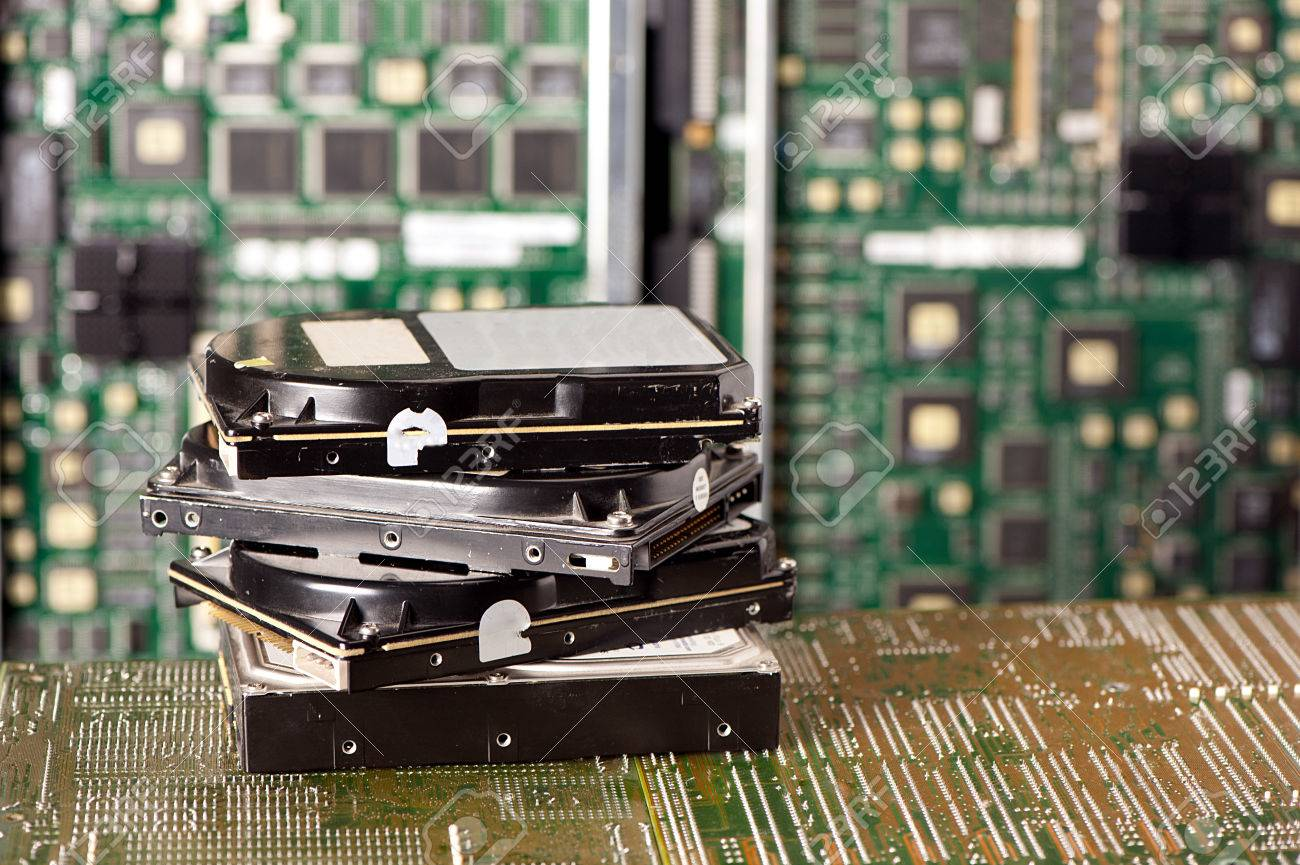 pile of hard drives and motherboard - 33924067