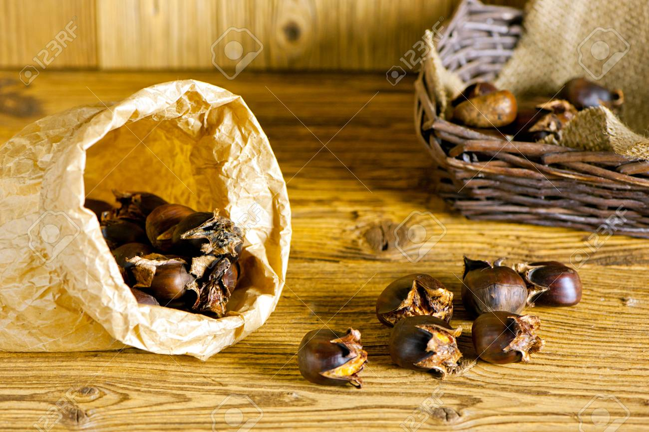 baked sweet chestnuts in paper bag - 35083601