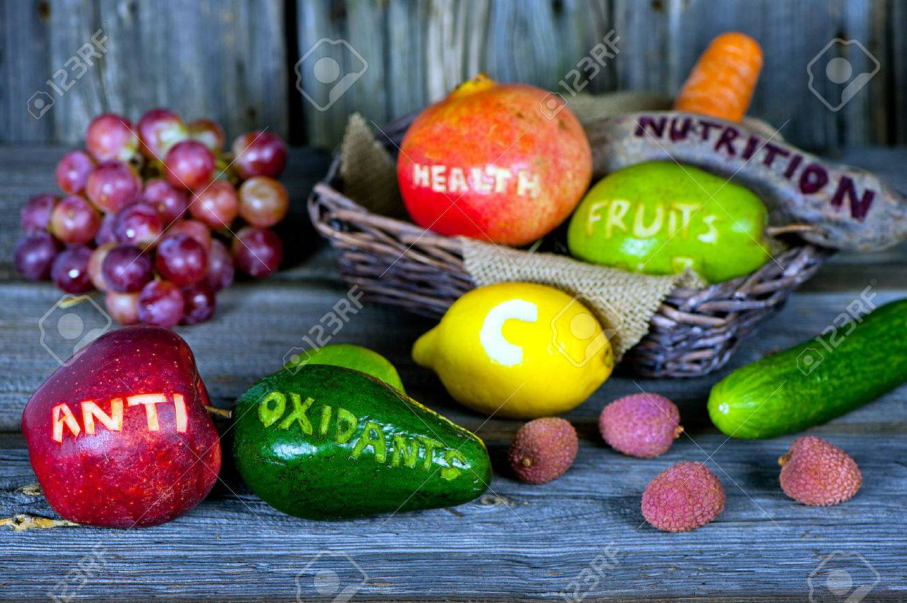 scattered fruits and vegetables with cut words - healthy lifestyle concept - 36018493