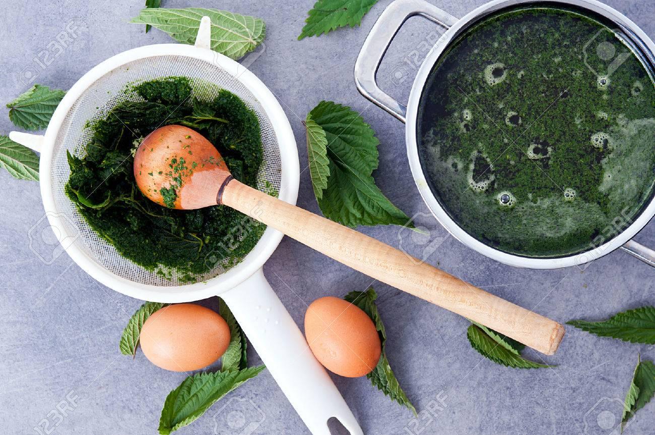 making vegetarian, healthy nettle soup - 61944992