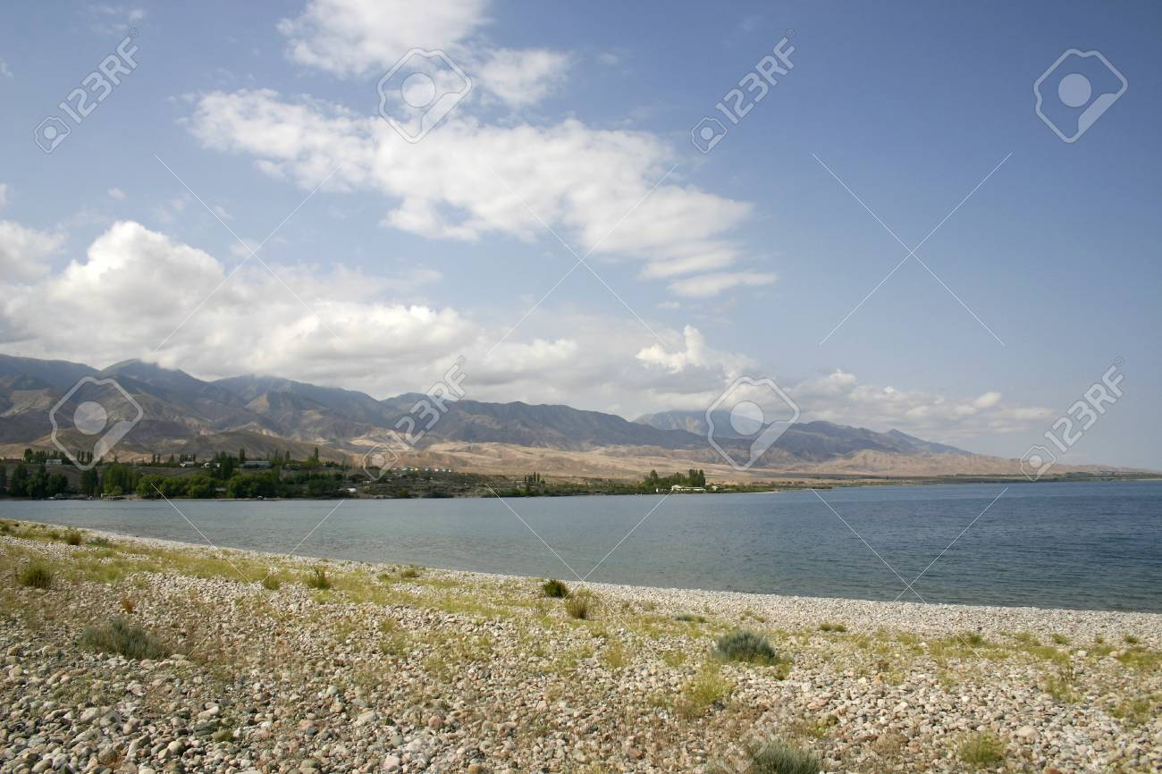 Stone coast of lake. Stock Photo - 13681515