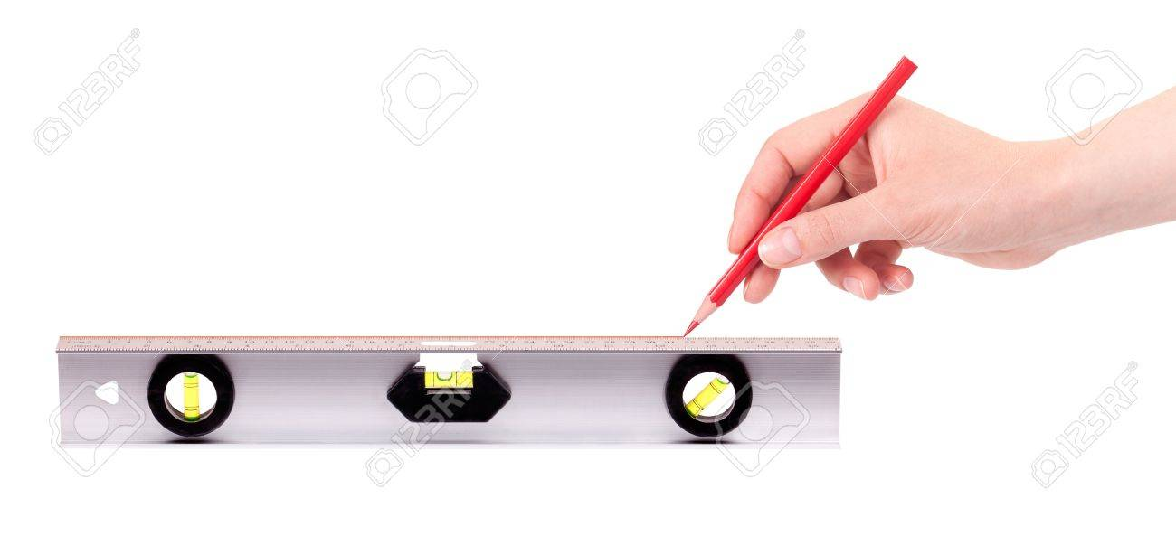 Hand drawing red line using a spirit level isolated on a white hand drawing red line using a spirit level isolated on a white background stock photo pooptronica