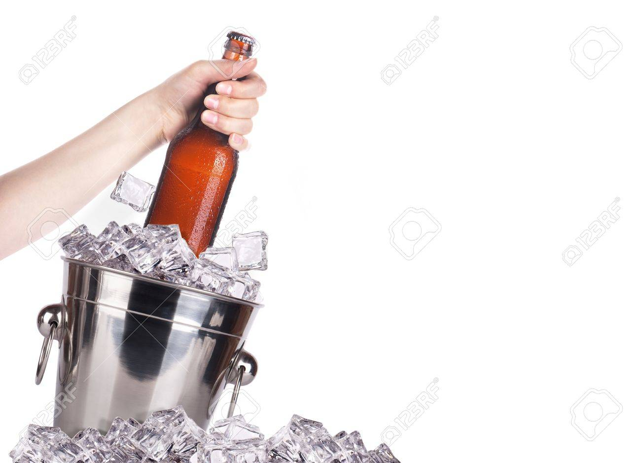 frosty beer with ice bucket and hand isolated on a white background Stock Photo - 16810549
