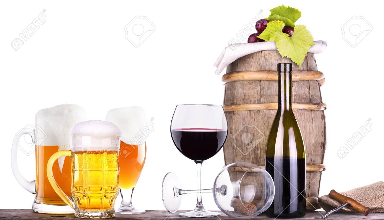 grapes on a wooden vintage barrel with corkscrew and beer glass isolated on a white background Stock Photo - 20480357