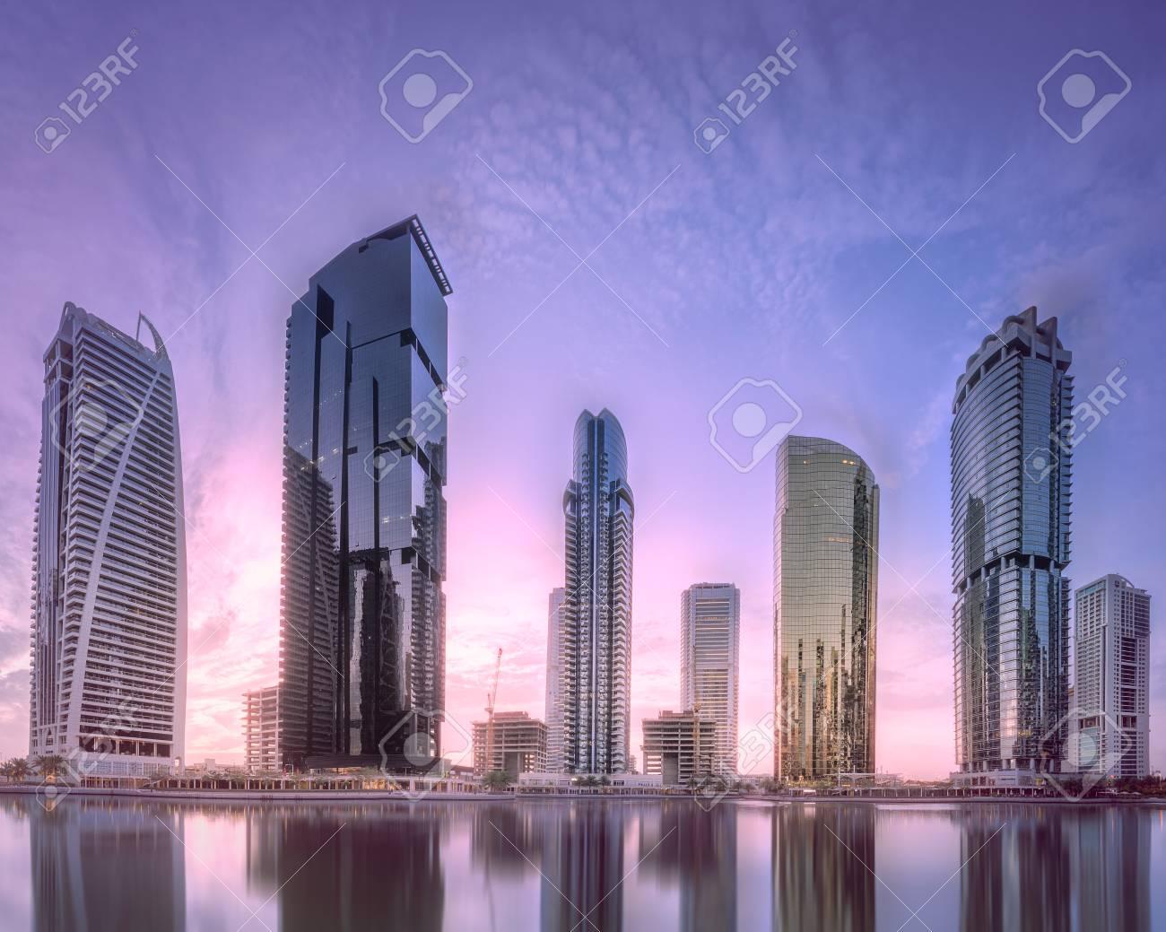 Jumeirah Lakes Towers in Dubai at purple sunrise - 103048896