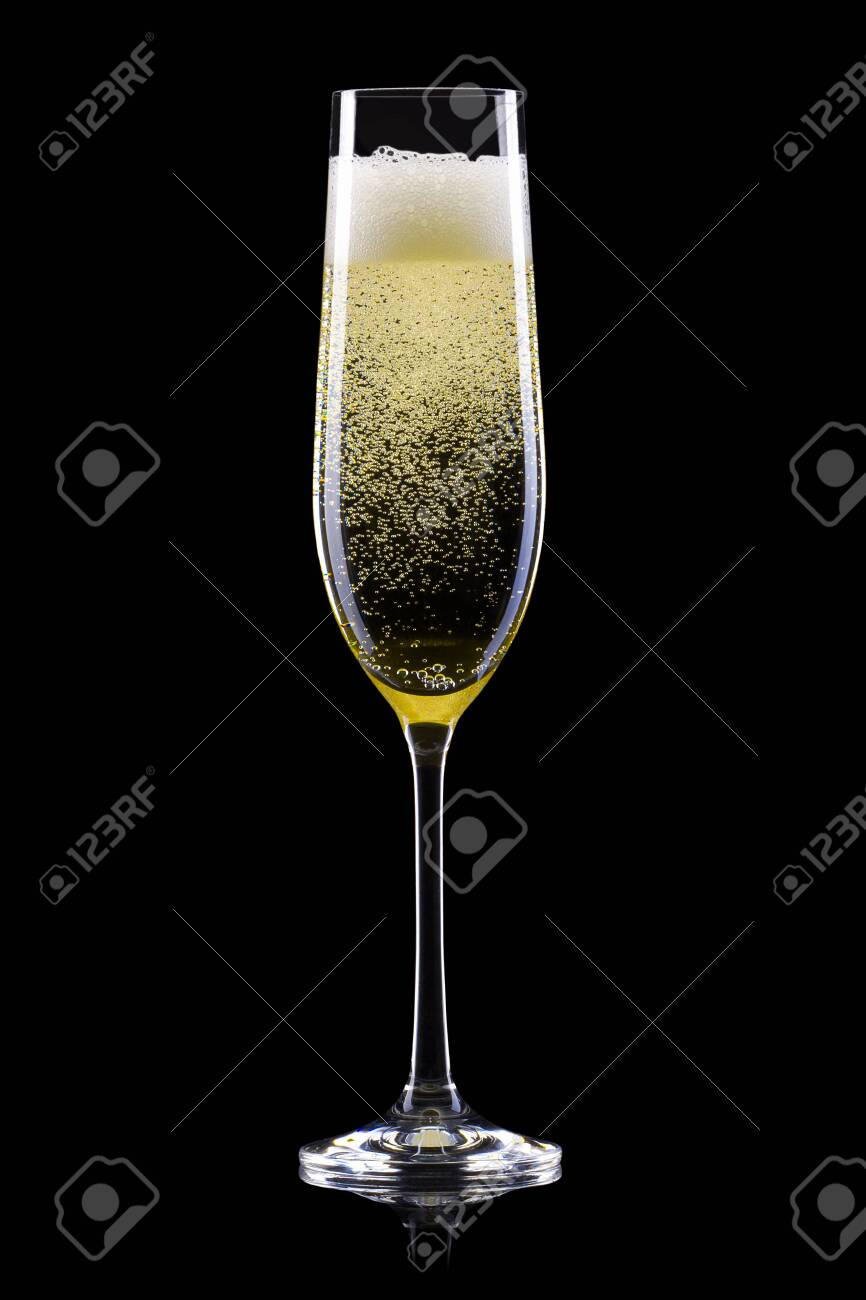 Glass for champagne with splashes on black background. Isolated with clipping path - 136793549