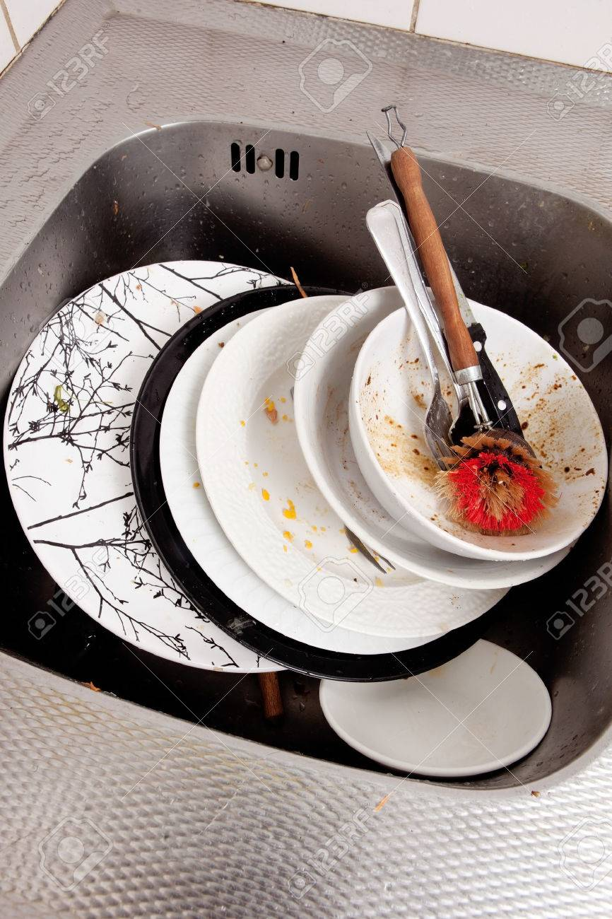 Kitchen Sink With Dishes dirty dishes in kitchen sink stock photo, picture and royalty free