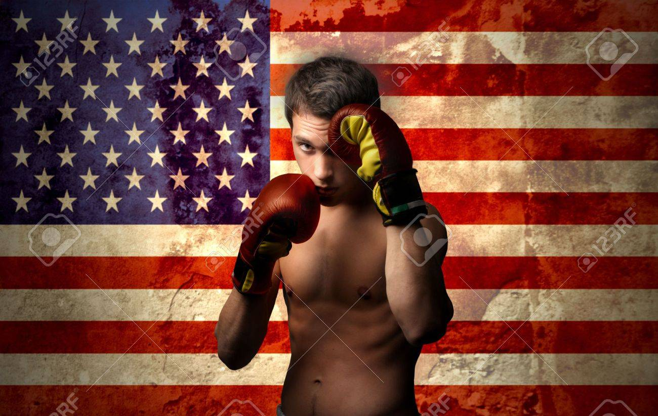 young boxer with american flag on the background Stock Photo - 5582889
