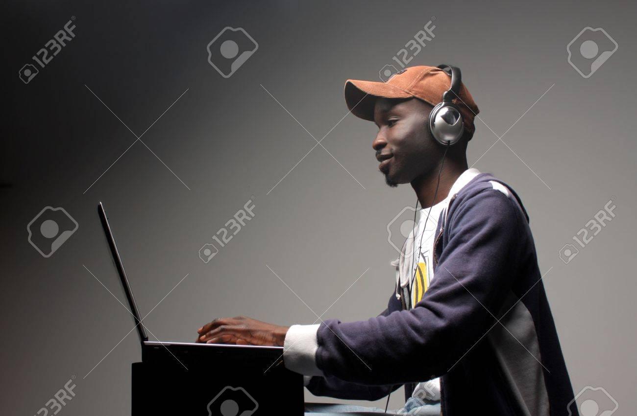 black boy loading music from internet Stock Photo - 5592597