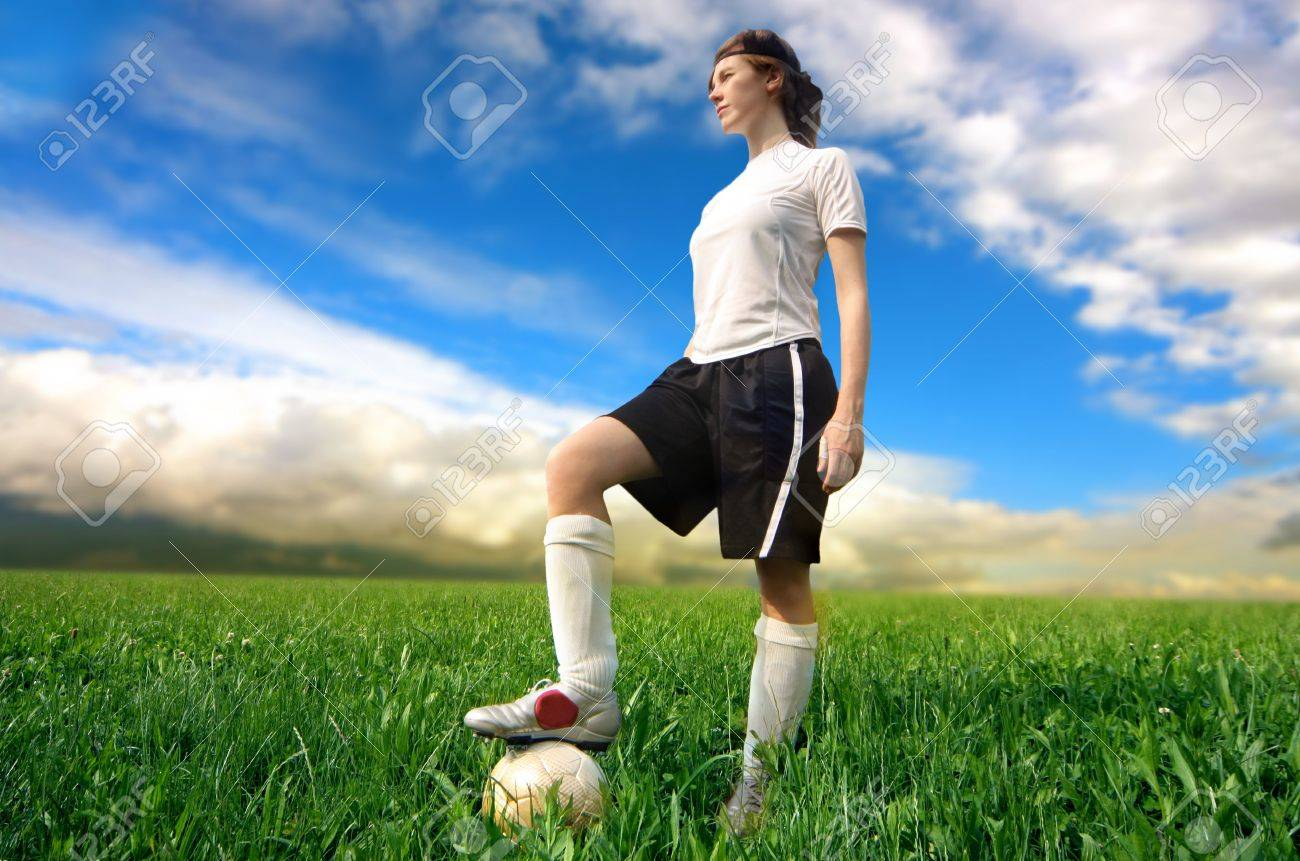 soccer or football female player standing in a grass field Stock Photo - 5611231