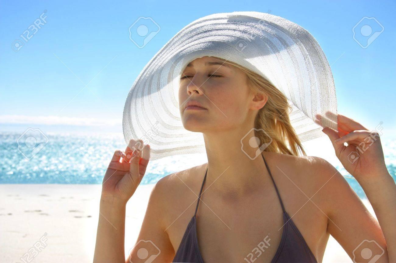 beautiful girl in bikini with hat at the sea Stock Photo - 5691178