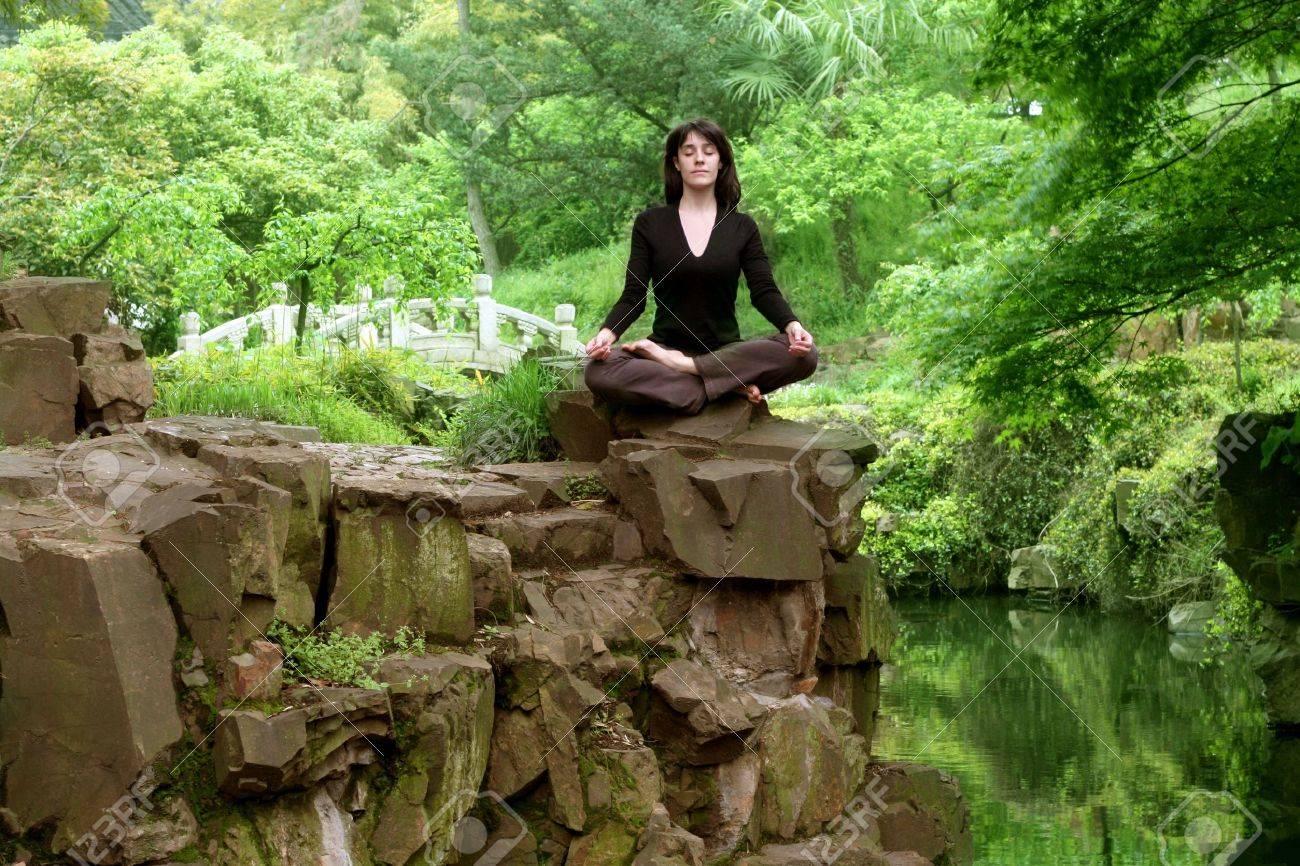 Beautiful Woman Practicing Yoga In A Oriental Garden Stock Photo   5721884