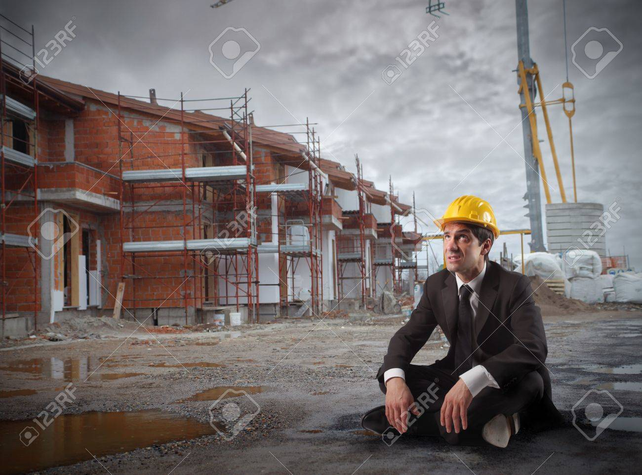 Businessman with helmet sitting in a construction site Stock Photo - 6534903