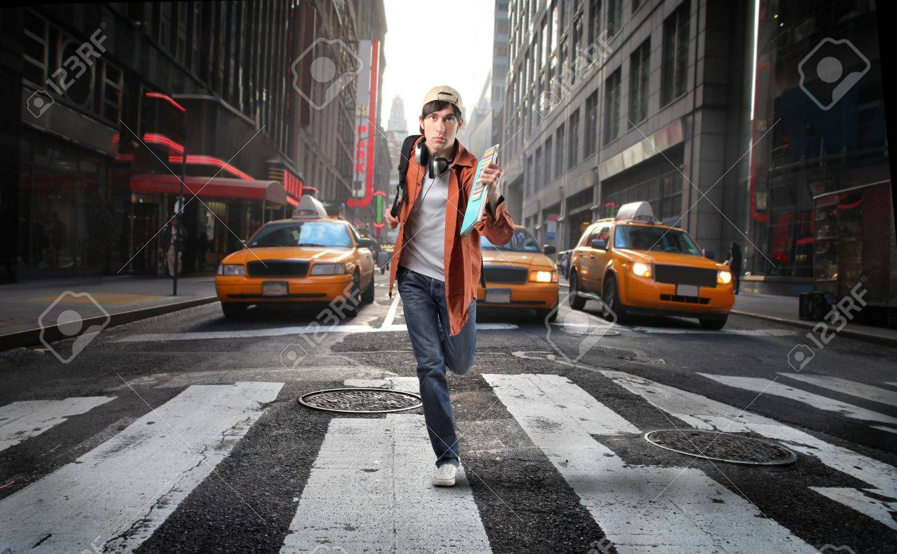 Young man running on a city street Stock Photo - 6534906