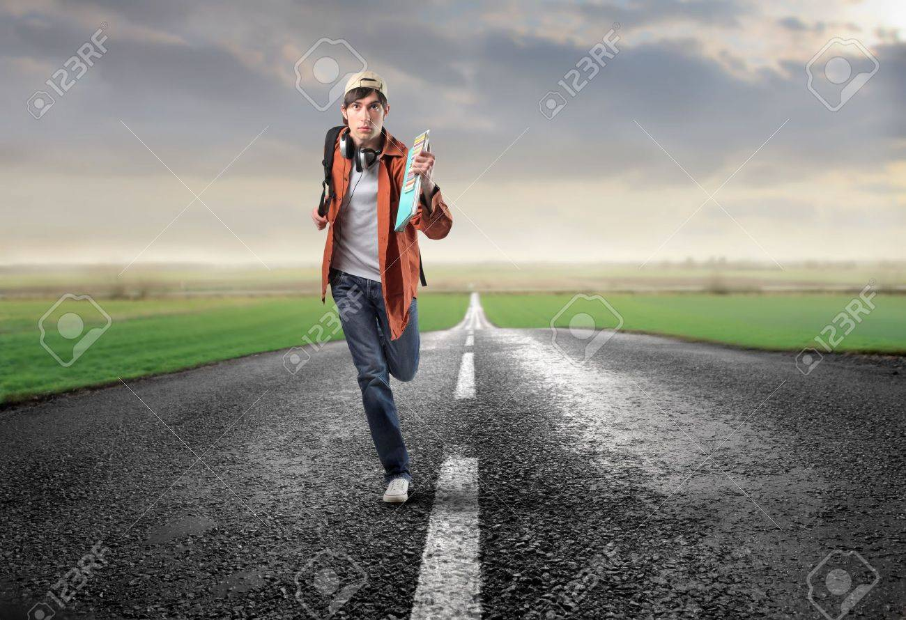 Young man running on a countryside road Stock Photo - 6534908