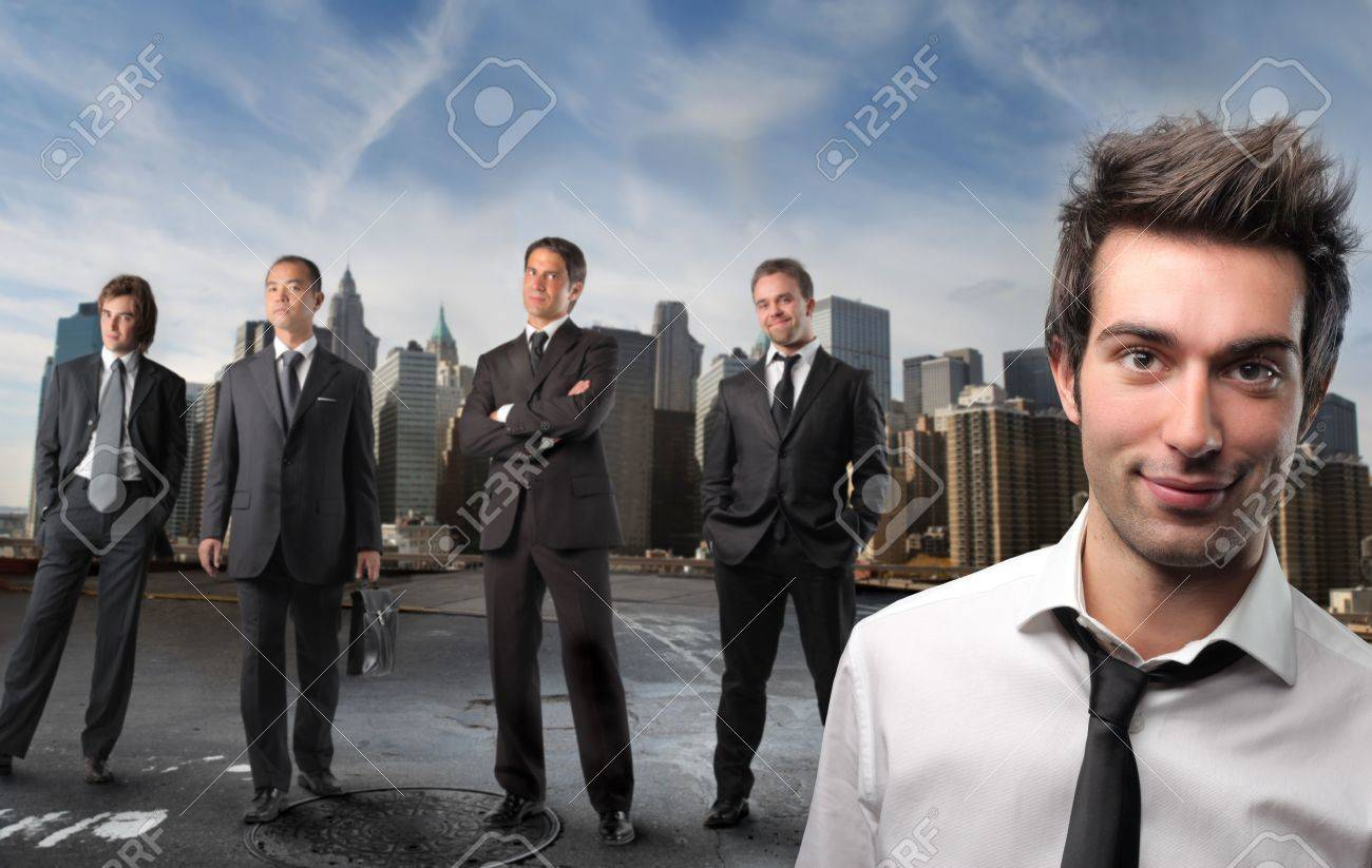 Smiling businessman and group of business people on the background Stock Photo - 6628081