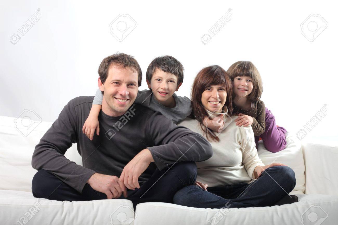 Happy family on a sofa Stock Photo - 6960797
