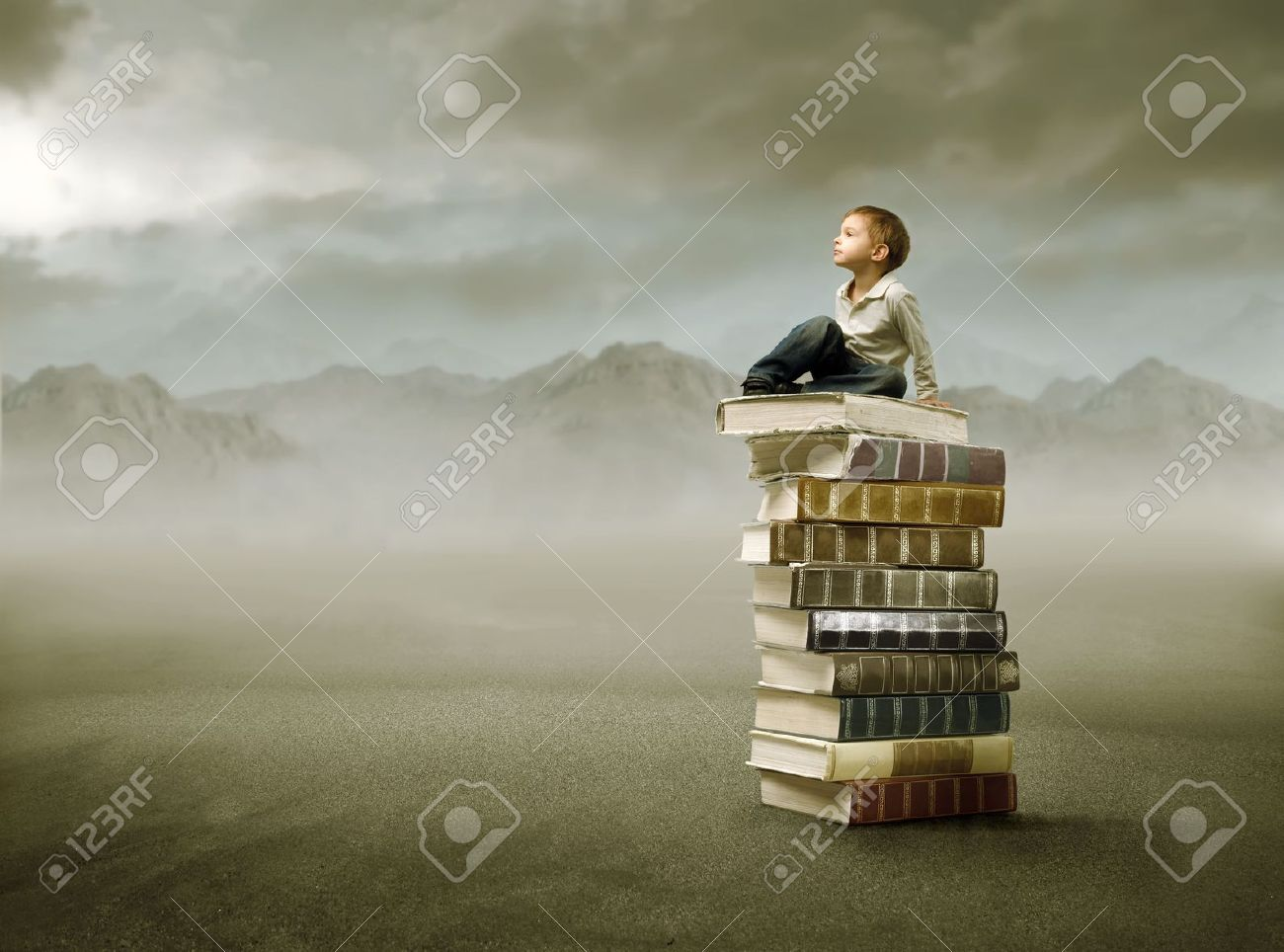 Child sitting on a stack of books in the mountains Stock Photo - 8054407