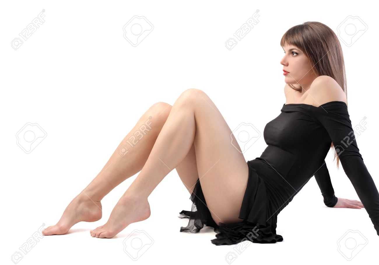 Seated beautiful woman with long legs Stock Photo - 8612303