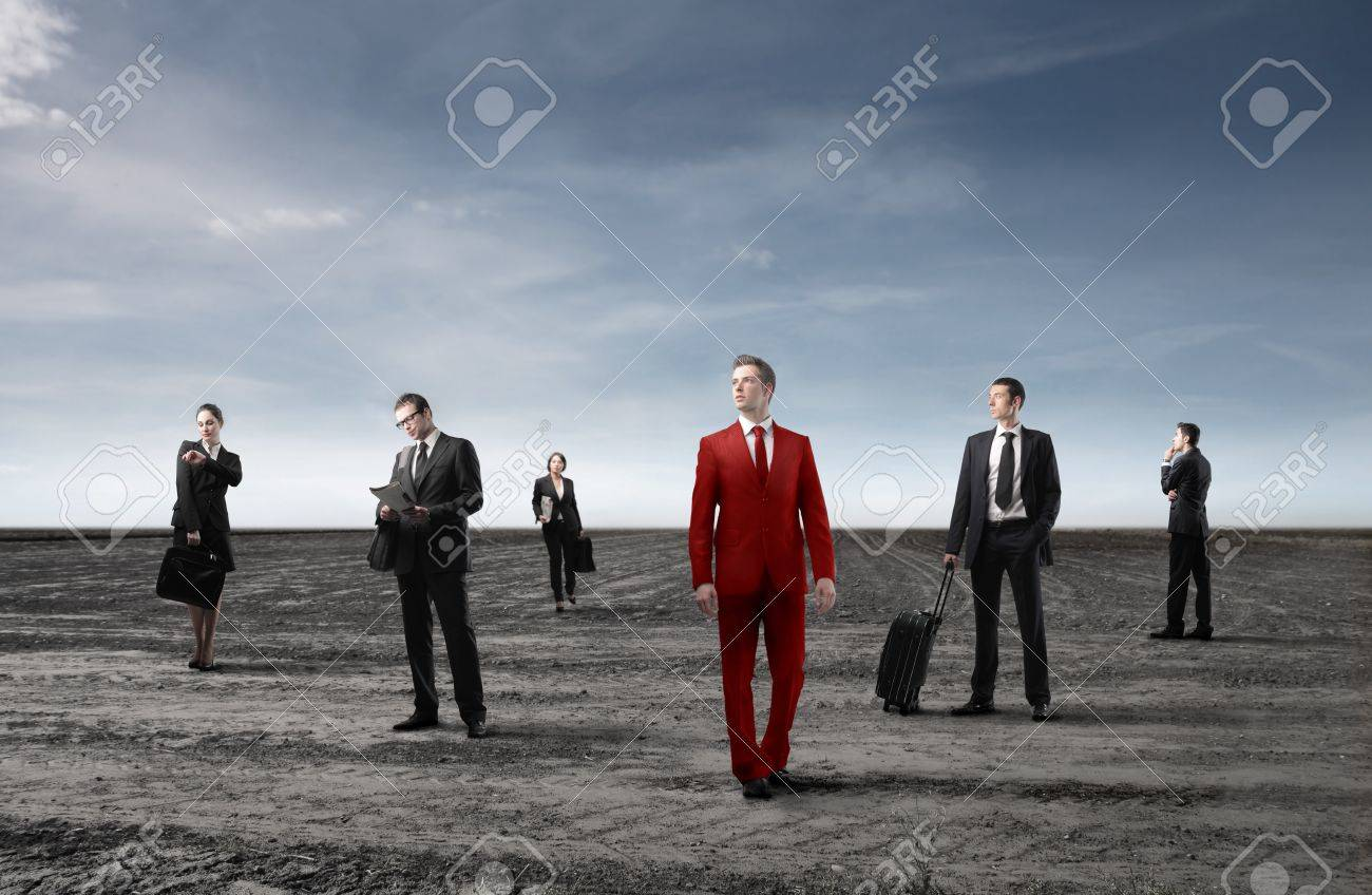 Group of business people in black and businessman in red Stock Photo - 8656325