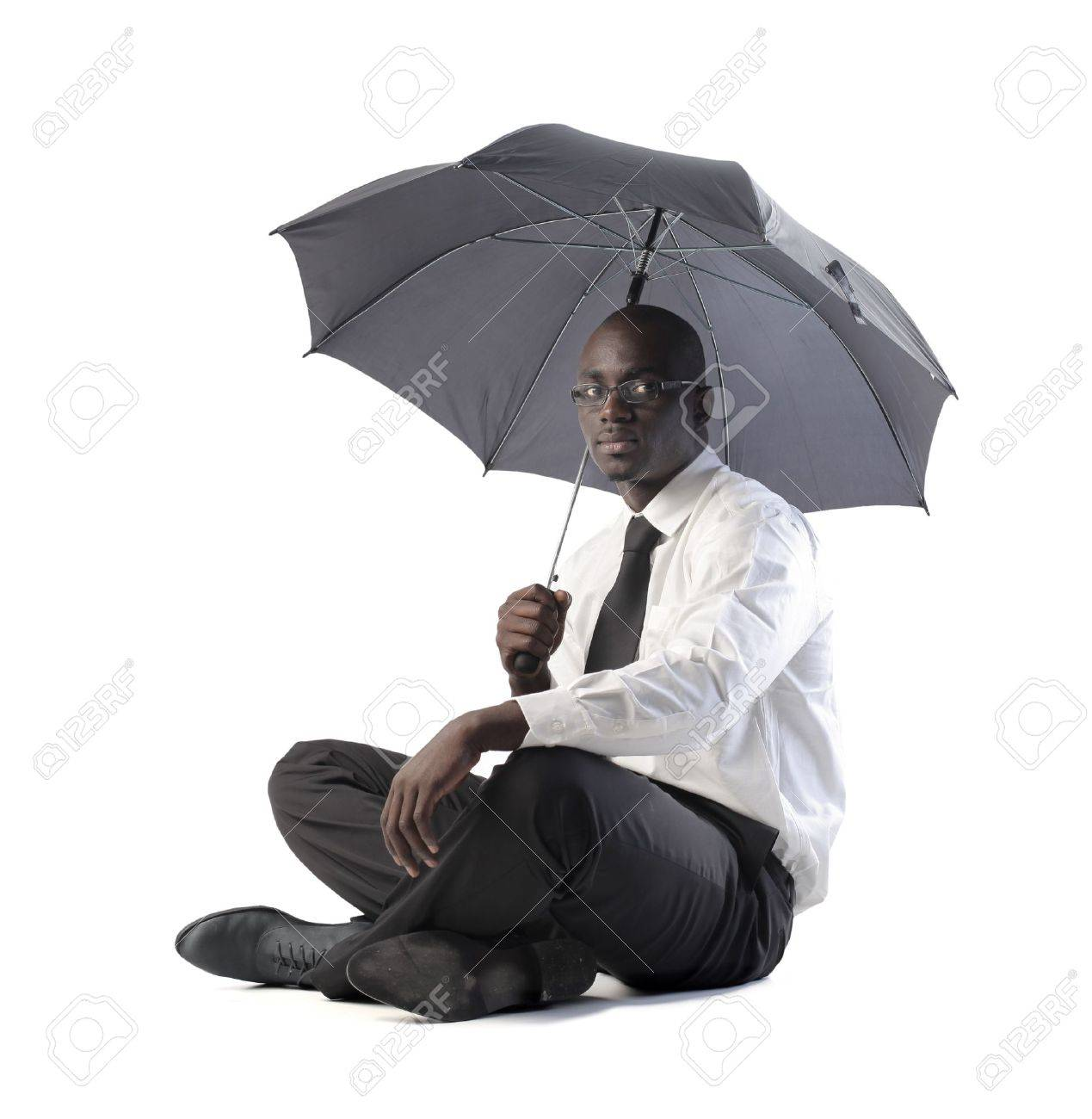 African businessman with umbrella Stock Photo - 8856422