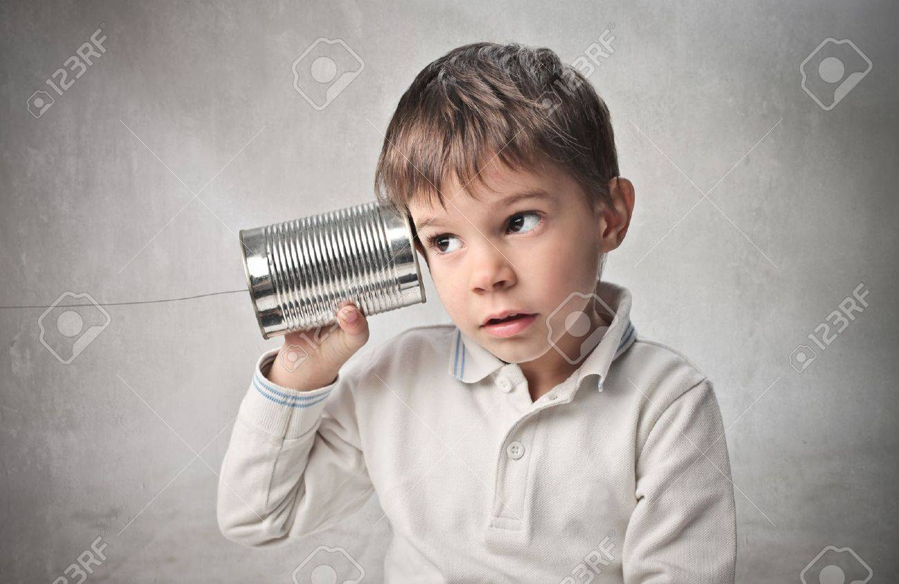Child using a can as telephone Stock Photo - 9943387