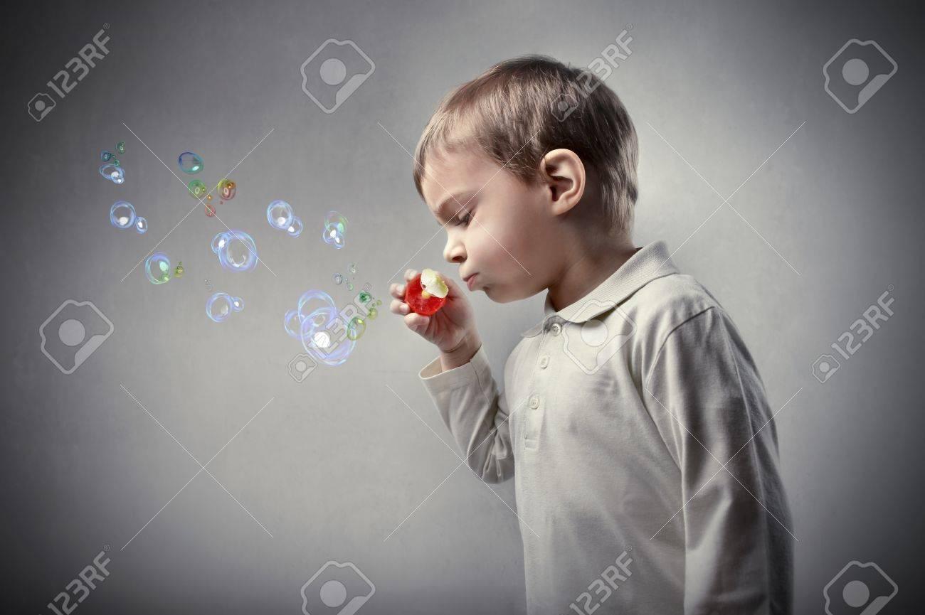 Kid Blowing Soap Bubbles Child Blowing Soap Bubbles