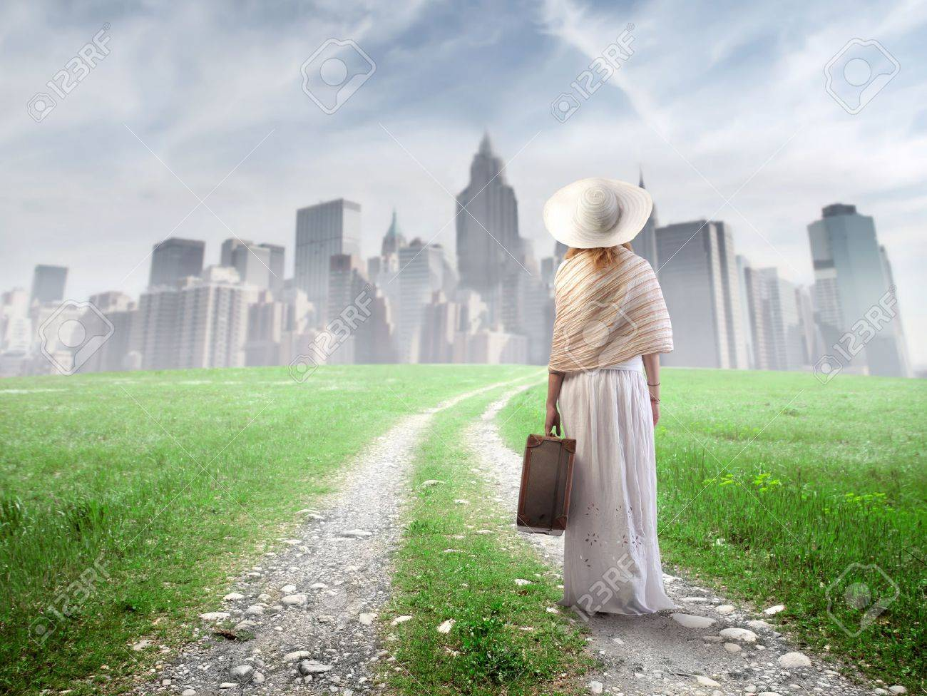 external image 10171737-Beautiful-woman-walking-towards-a-big-city-a-suitcase-in-her-hand-Stock-Photo.jpg