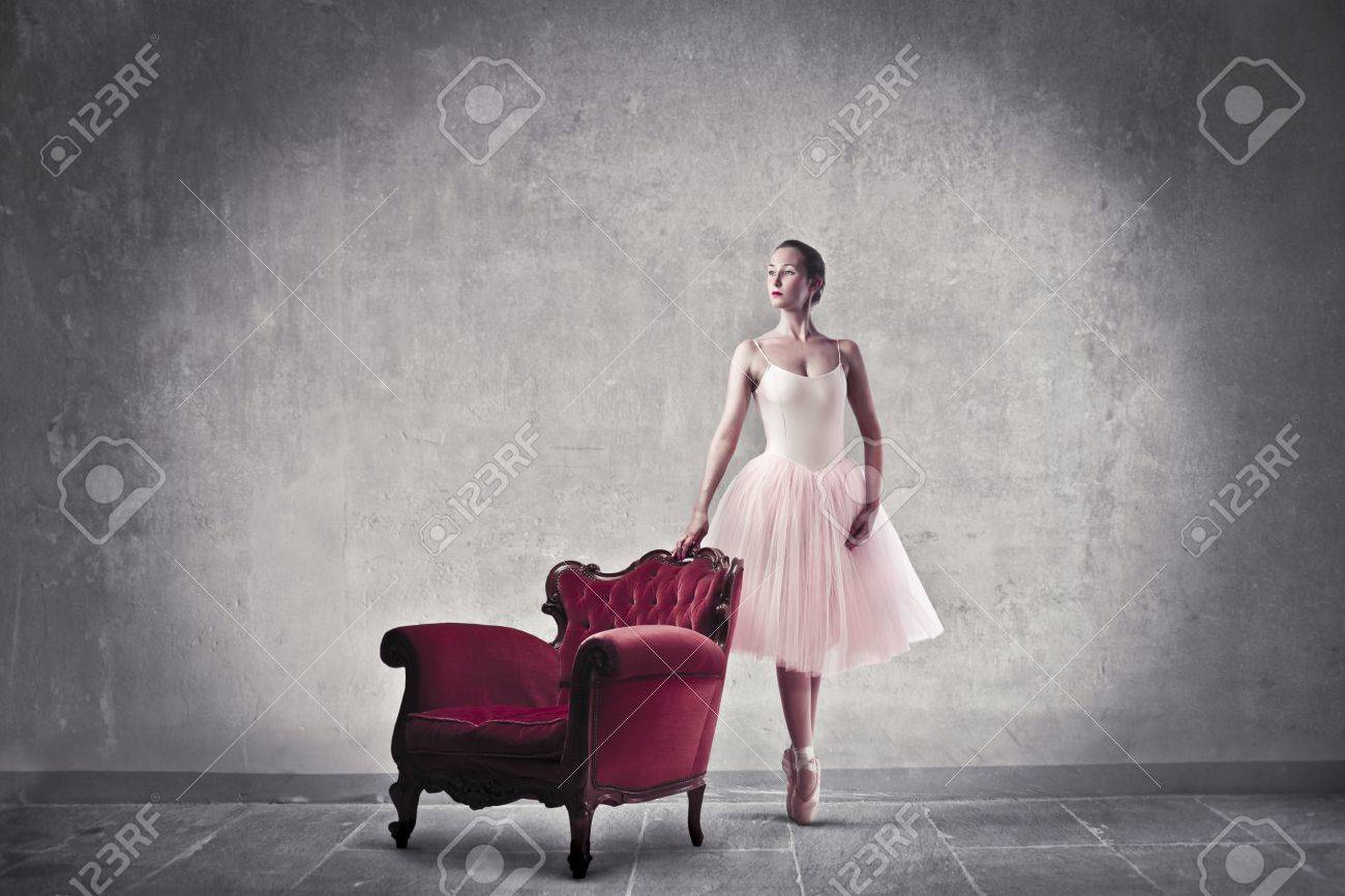Ballerina standing beside an armchair Stock Photo - 10616710