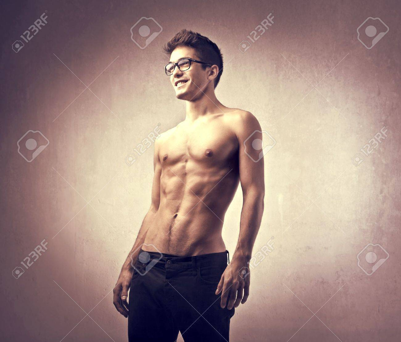 Handsome brawny bare-chested man Stock Photo - 10916913
