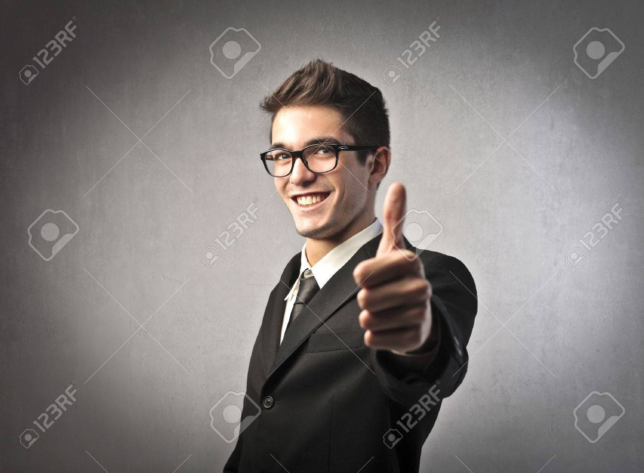 Smiling businessman with thumbs up Stock Photo - 10916941