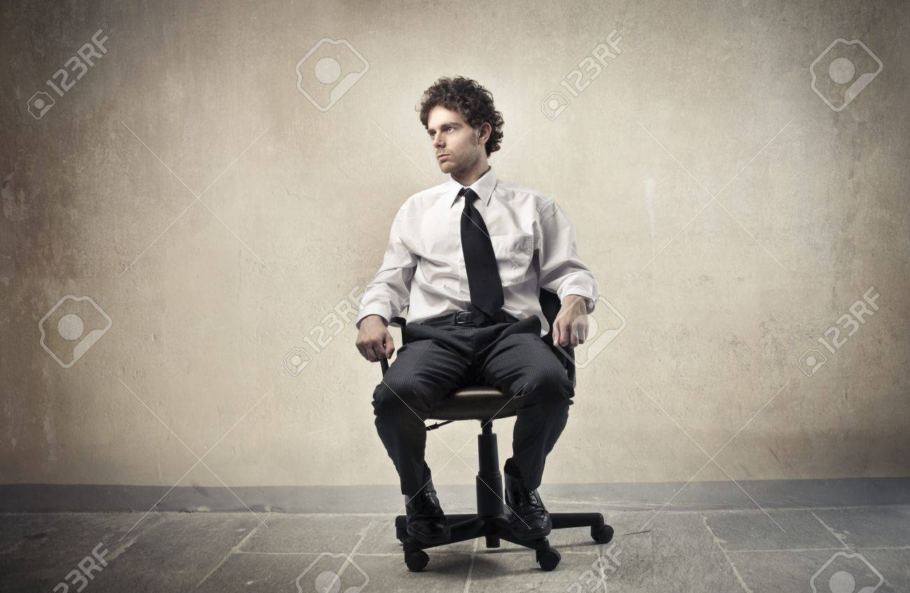 Young businessman sitting on an office chair Stock Photo - 11102883