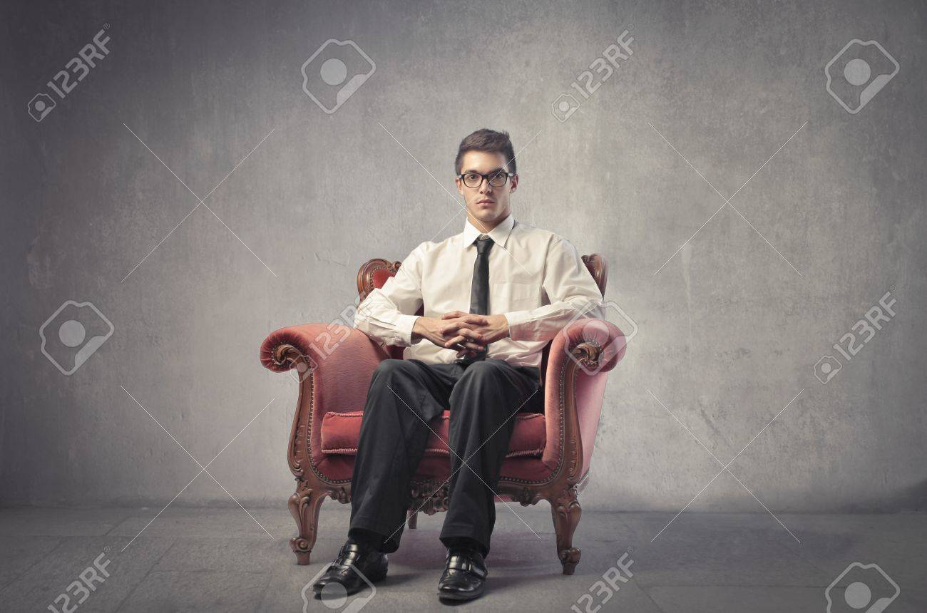 Young businessman sitting on an armchair Stock Photo - 11227271