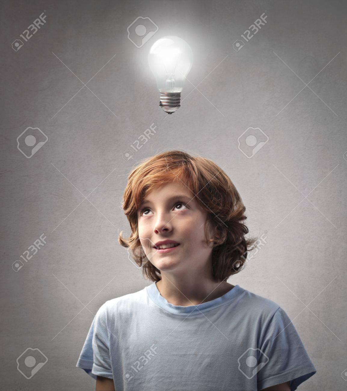 Smiling child having an idea Stock Photo - 11309302
