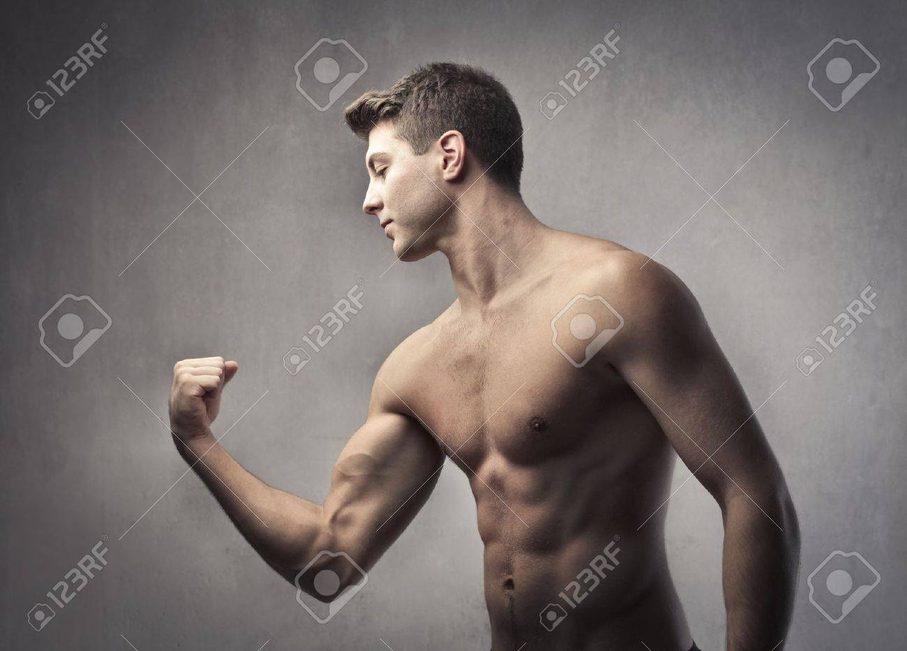 Handsome bare-chested man showing his biceps Stock Photo - 11489933