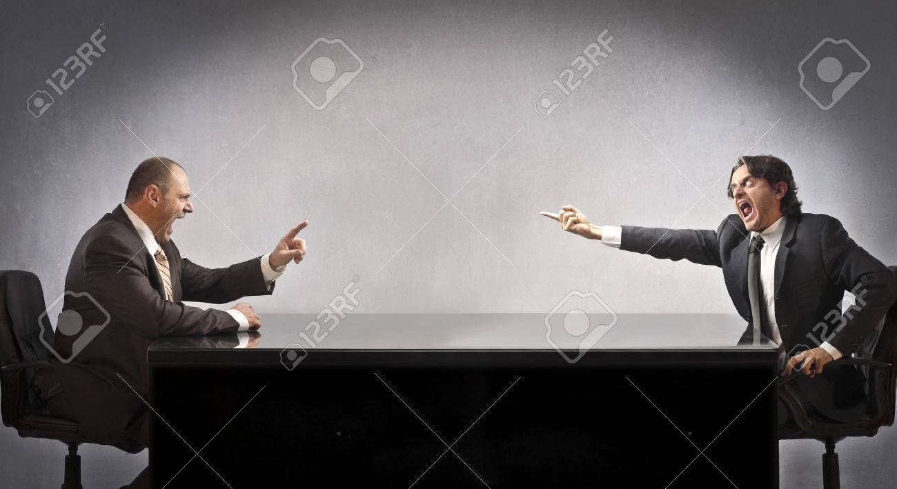 Two businessmen sitting at a table and quarreling Stock Photo - 11571332