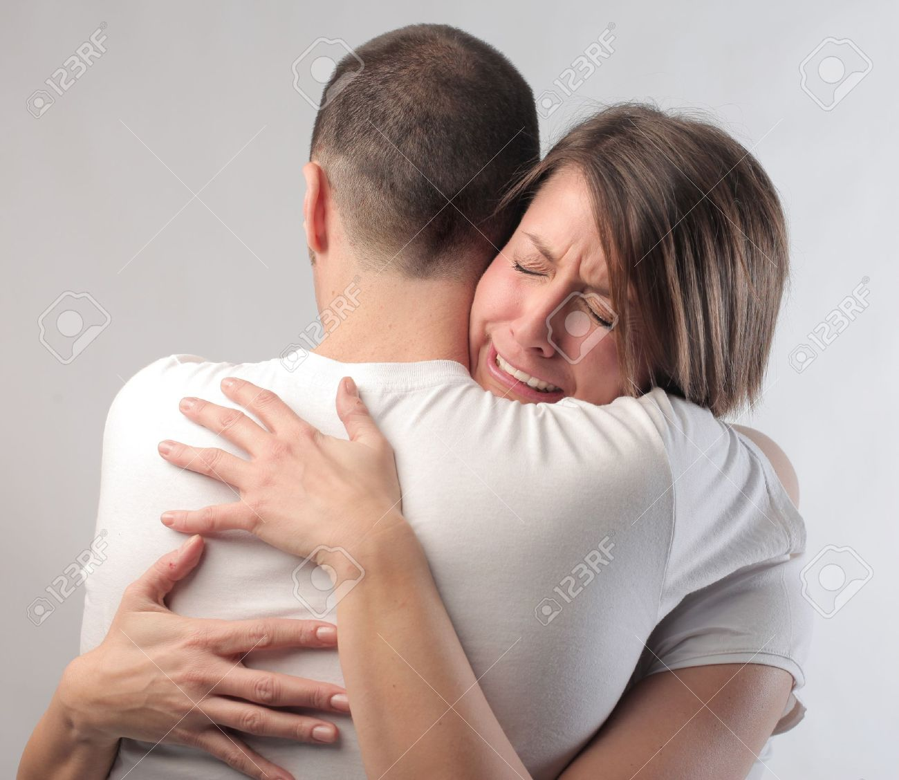 Sad Woman Hugging Her Husband Stock Photo, Picture And Royalty ...