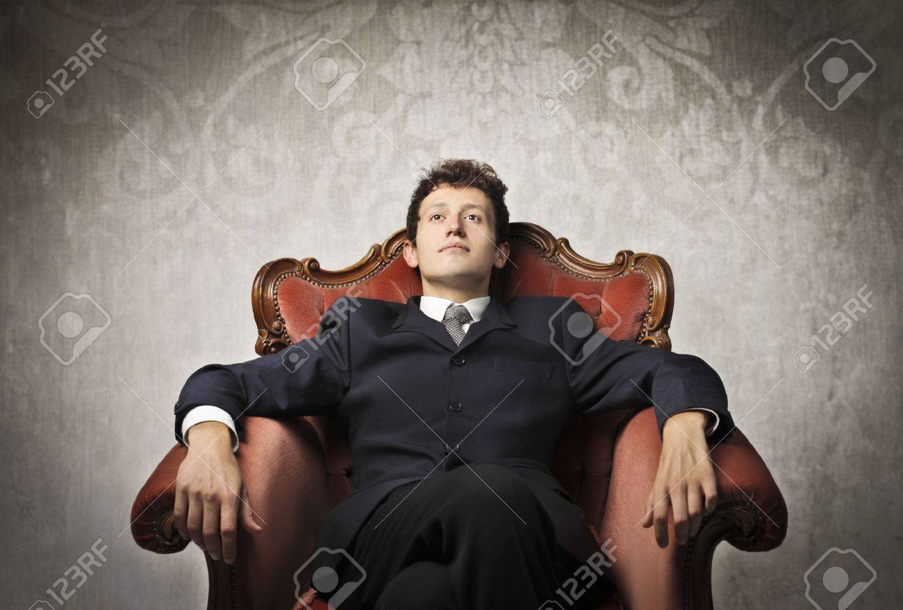 Young businessman relaxing on an armchair Stock Photo - 13639640