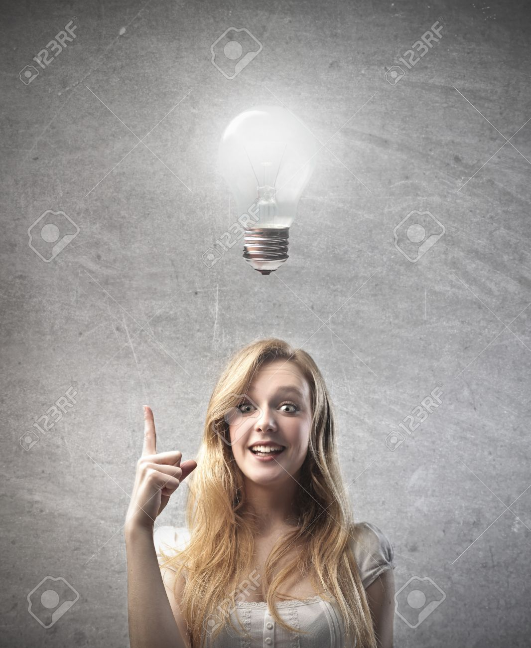 Smiling Young Woman Having An Idea With Light Bulb Over Her Head ... for Idea Light Bulb Over Head  303mzq