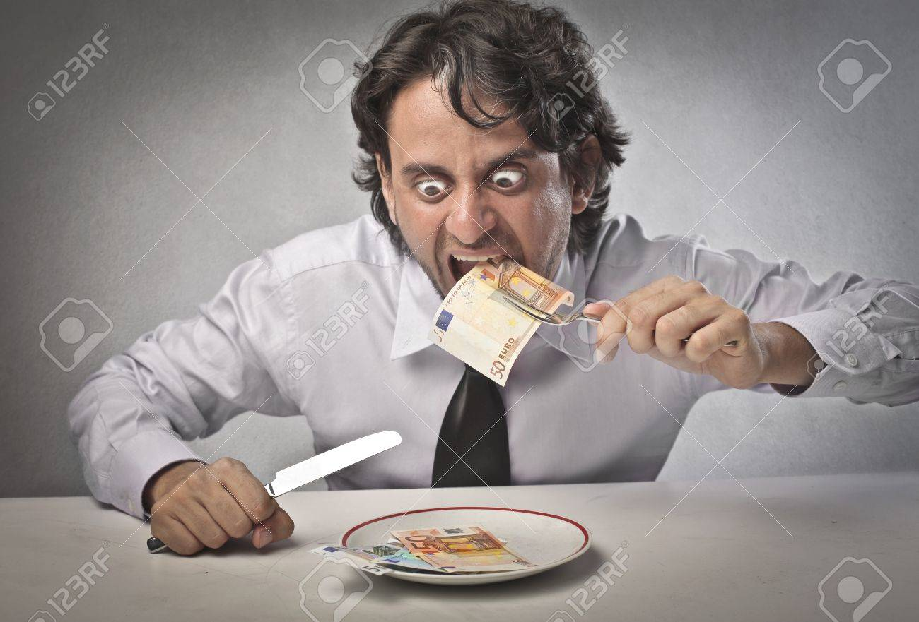 Businessman eating his earning - 14460899