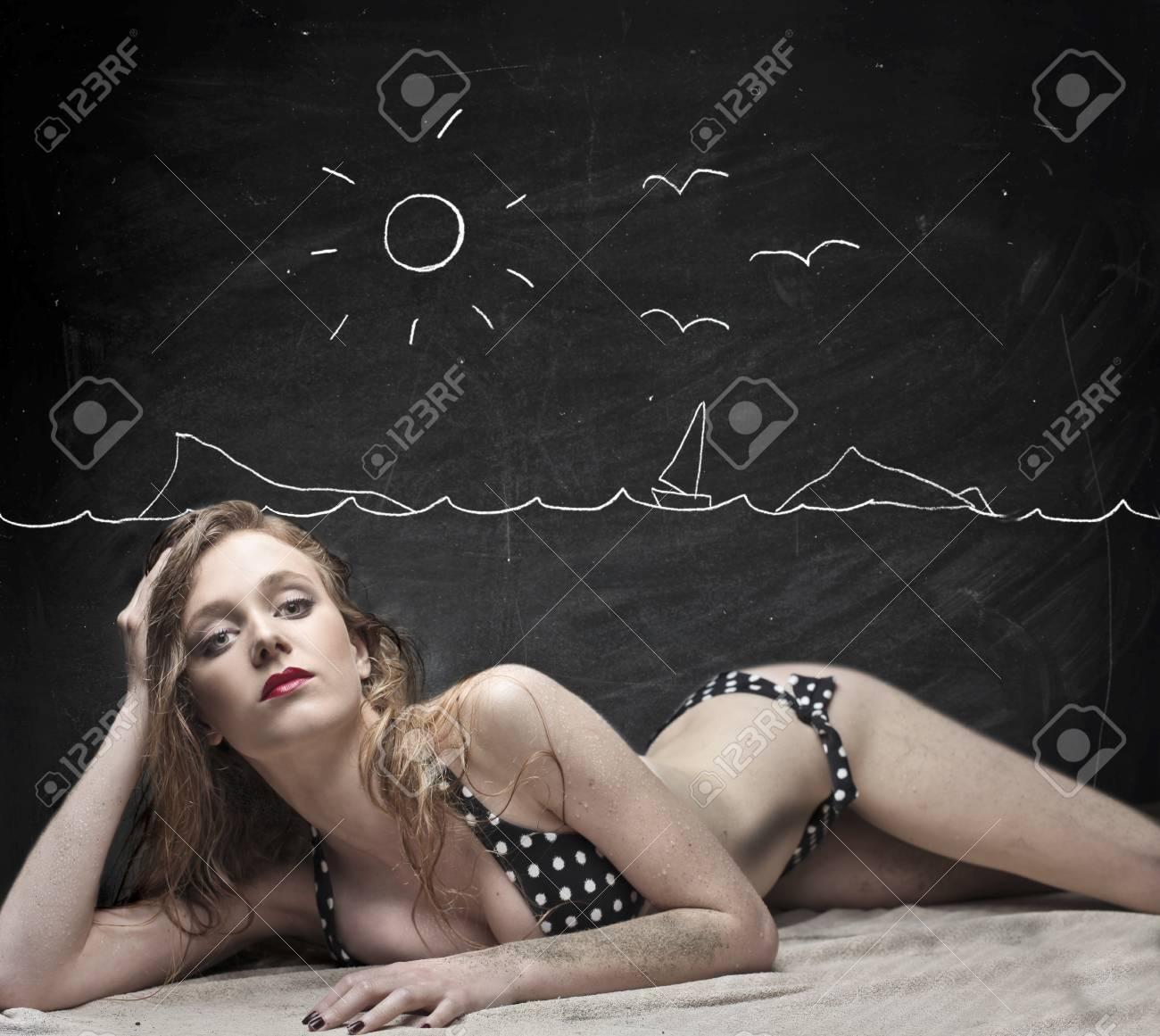 Beautiful blonde girl posing in bikini on a beach drawn on a blackboard Stock Photo - 15512907