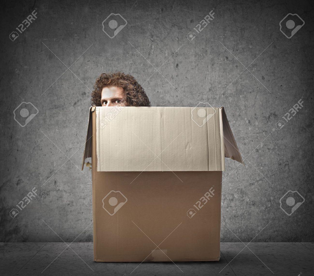 Man hiding behind a box - 15662596