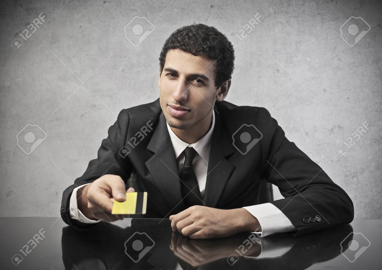 businessman sitting at the table with credit card in hand Stock Photo - 17218757