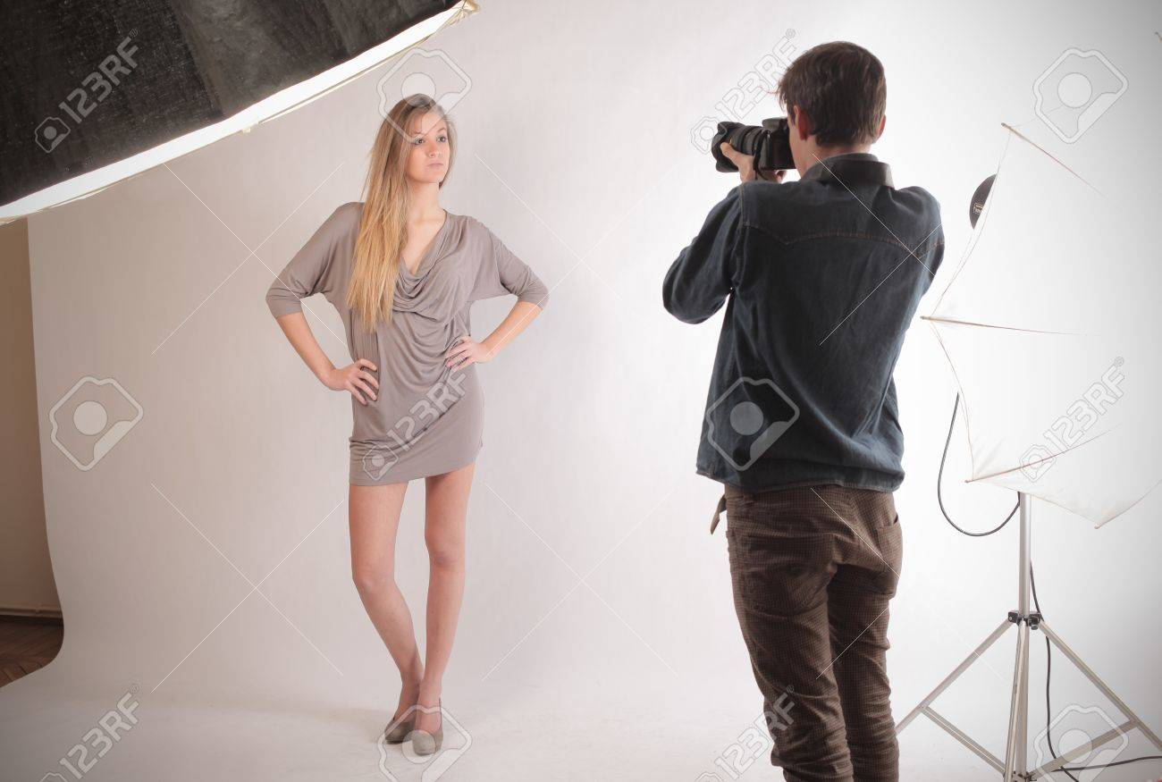 blond model posing in front of photographer Stock Photo - 17254749