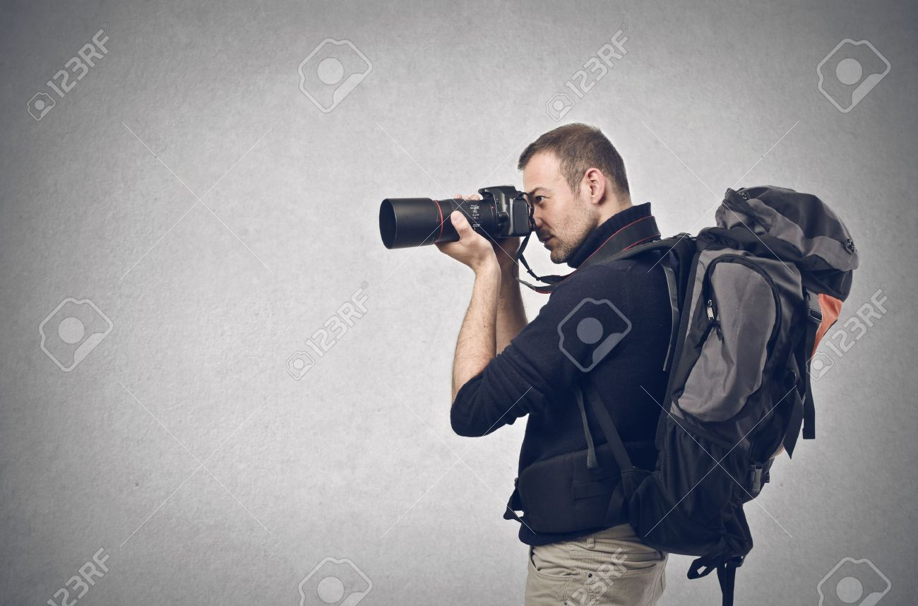 photographer takes a picture with professional camera Stock Photo - 17765956
