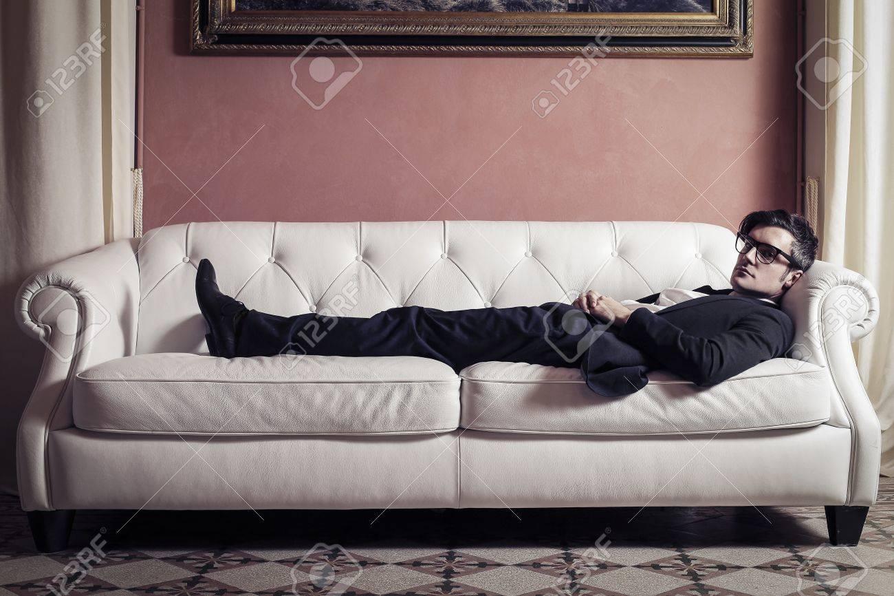 young businessman sleeping on the sofa Stock Photo - 18294870