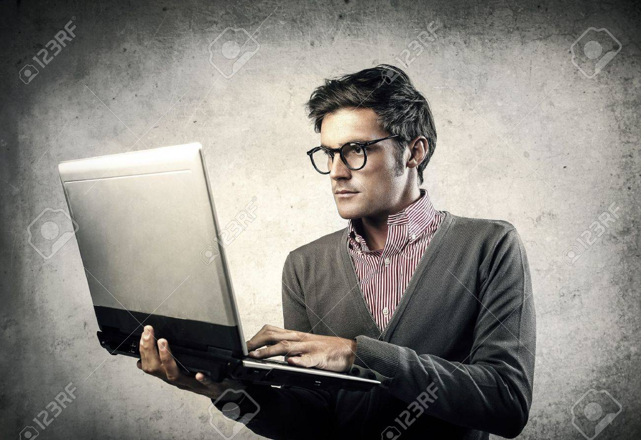 young businessman working with laptop Stock Photo - 18294878
